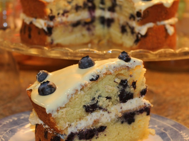 Vanilla Cake With Vanilla Icing And Blueberry Filling