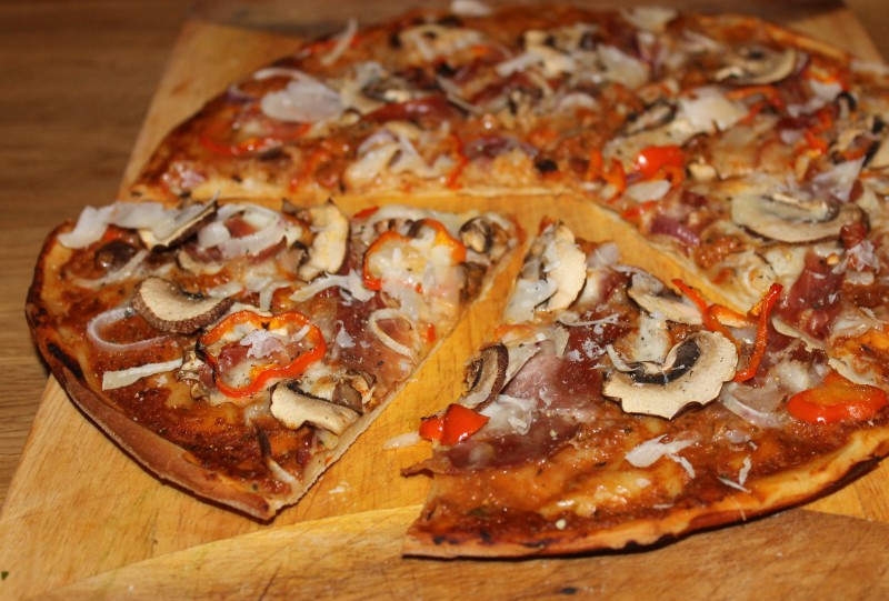 Red Pesto Based Pizza with Parma Ham, Chestnut Mushrooms, Peppers and Red Onion