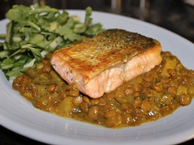 Pan Fried Salmon Served on a Bed of Curried Lentils with a Green Citrus Salad