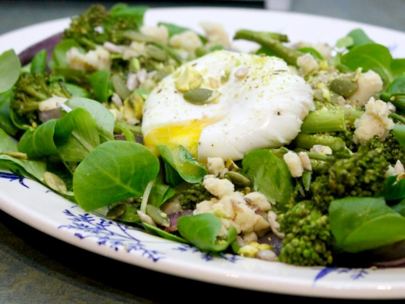 Roasted Tenderstem Salad with Crumbly Cheese, Toasted Seeds and a Poached Egg