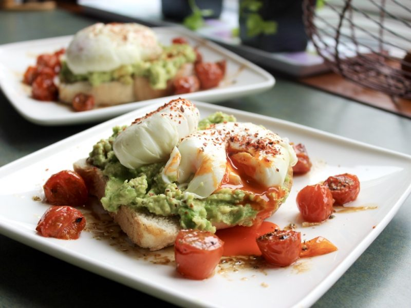 Smashed Avocado and Roasted Tomatoes on Toast, Topped with a Poached Burford Brown Egg