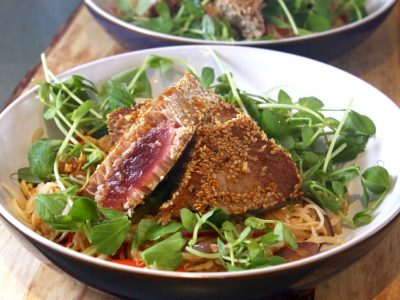 Sesame and Soy Crusted Tuna Steaks with Noodle and Pea Shoot Salad and a Sticky Ginger Dressing